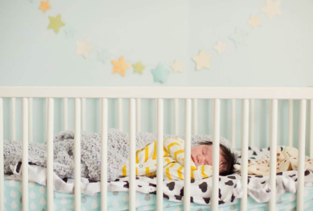 best crib for short moms stock photo for practical parents in training blog
