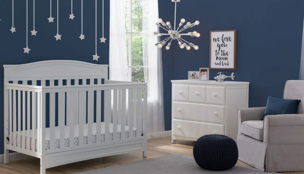 delta children emergy baby crib in a room with other decorations