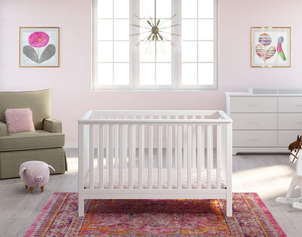 storkcraft baby crib in pink room preview photo