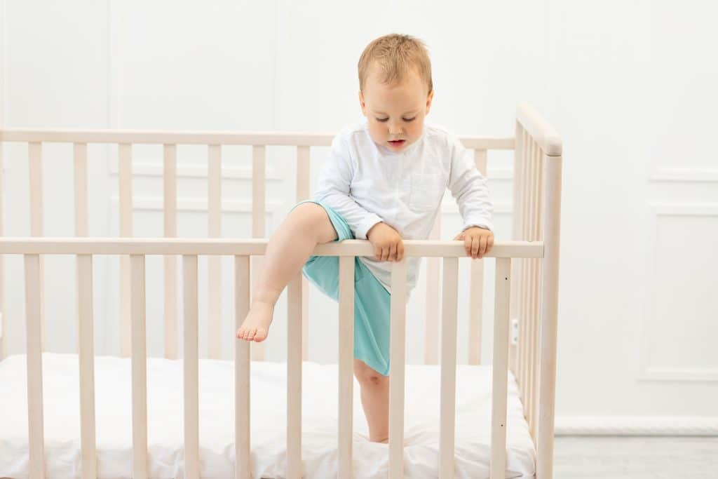 baby climbs out the crib because the mattress height is too high